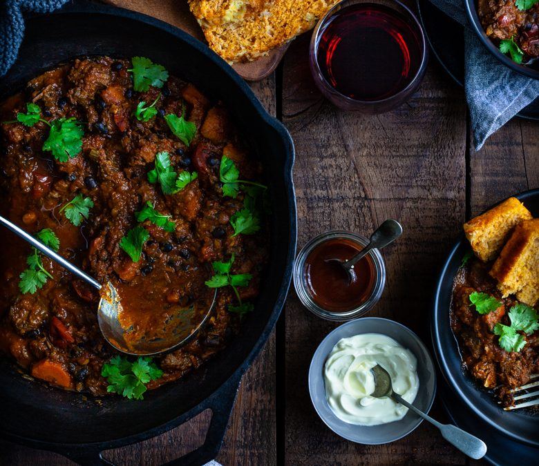 Smoky braised beef with pumpkin, black beans and cornbread
