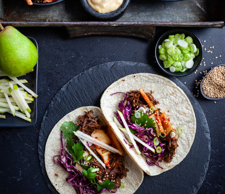 Korean inspired beef tacos with kimchi and pear