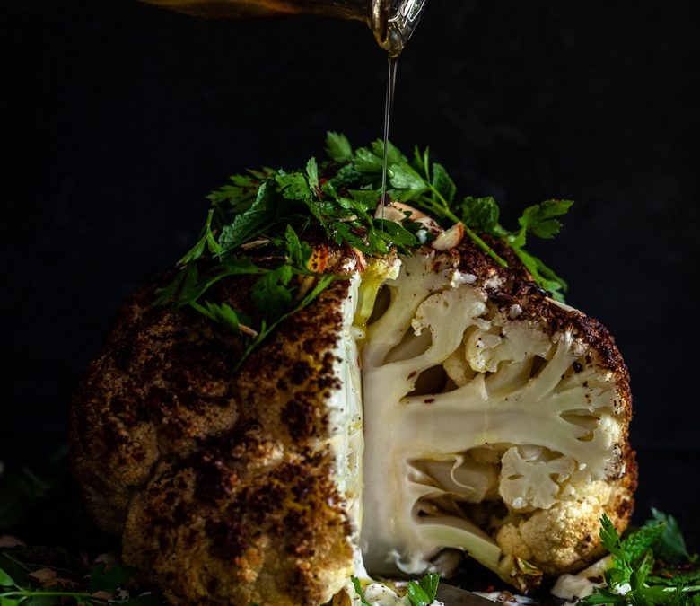 Whole roasted spiced cauliflower with sumac, yoghurt and herbs