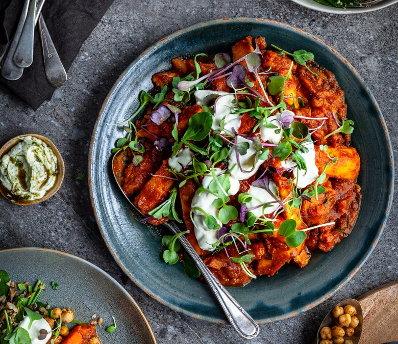 Root vegetable tajine with spiced chickpeas, yoghurt and herbs