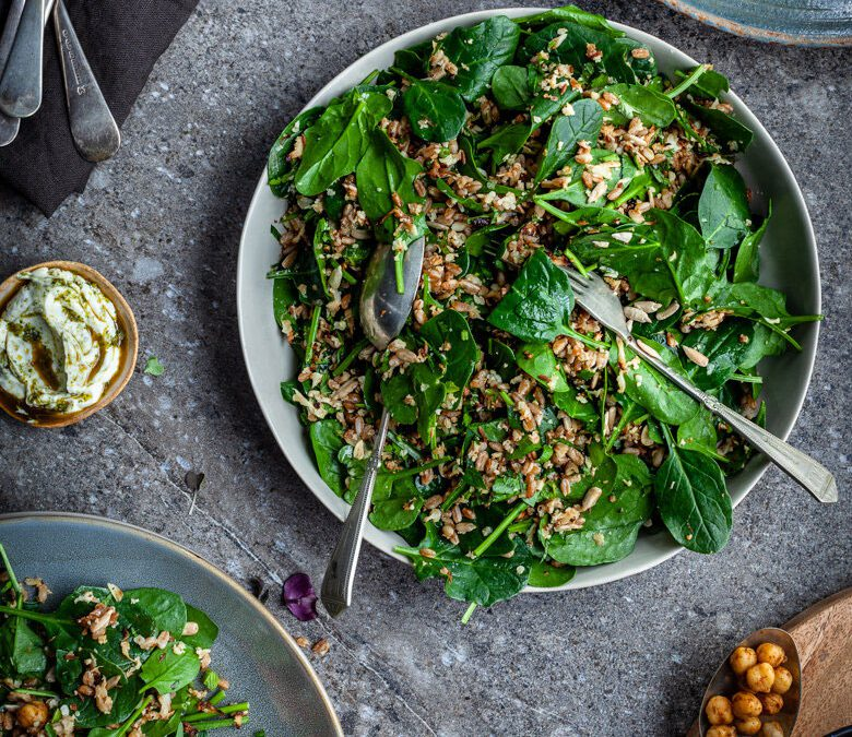 Roast cauliflower and grain salad with herbs and baby spinach